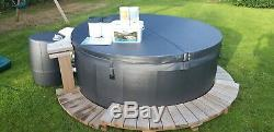 Softub hot tub. 6 person, variable jets, led colour change lights. Not used! 5k